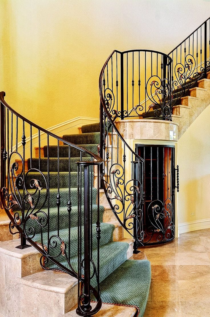 European-style home in Boca Raton features a marvelous staircase with a room for storage underneath - perfect for a wine room!