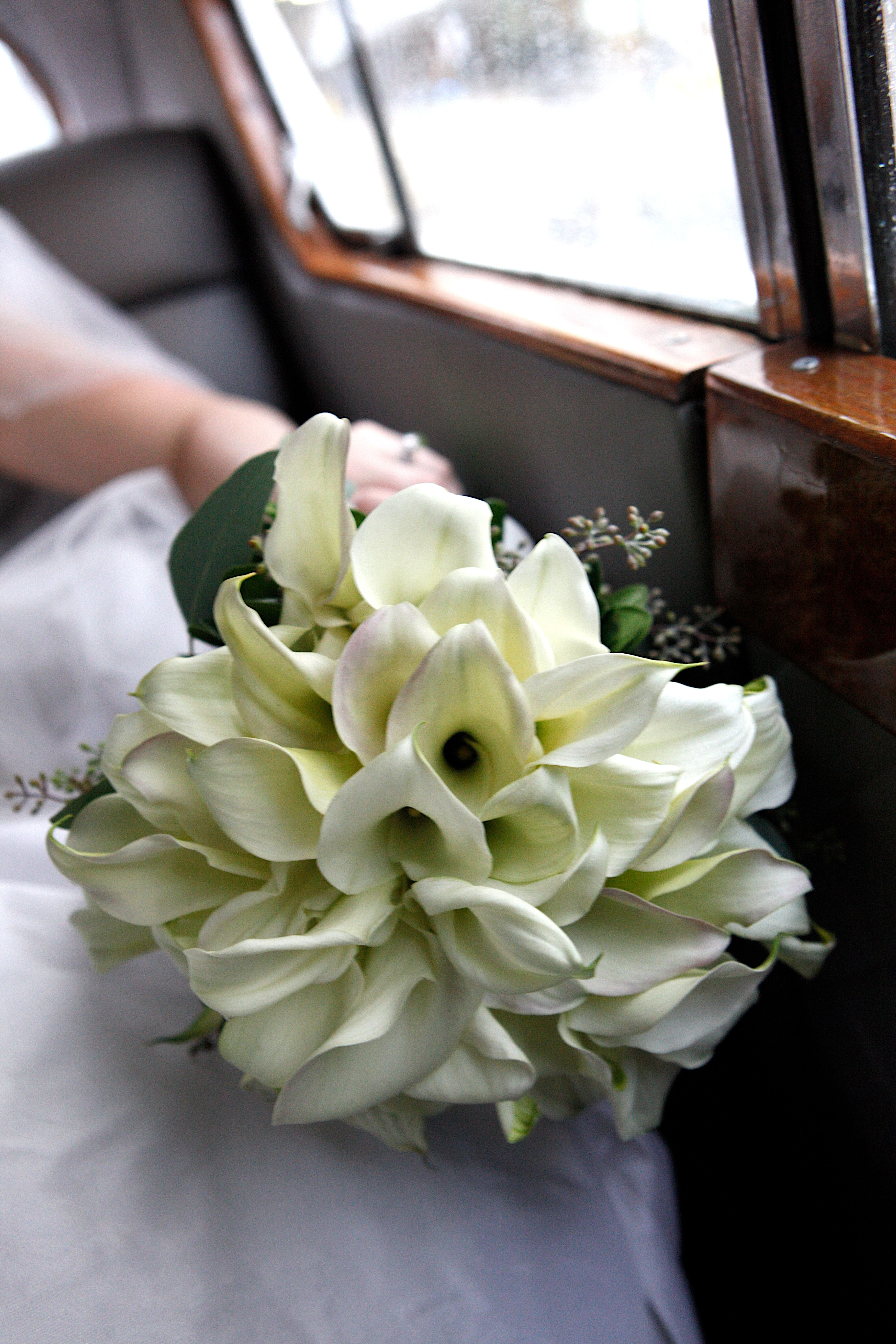 Gorgeous calla lilies in the bride's bouquet.  Photo courtesy of Big Cake Photography Florals: @Sharon Floral Design