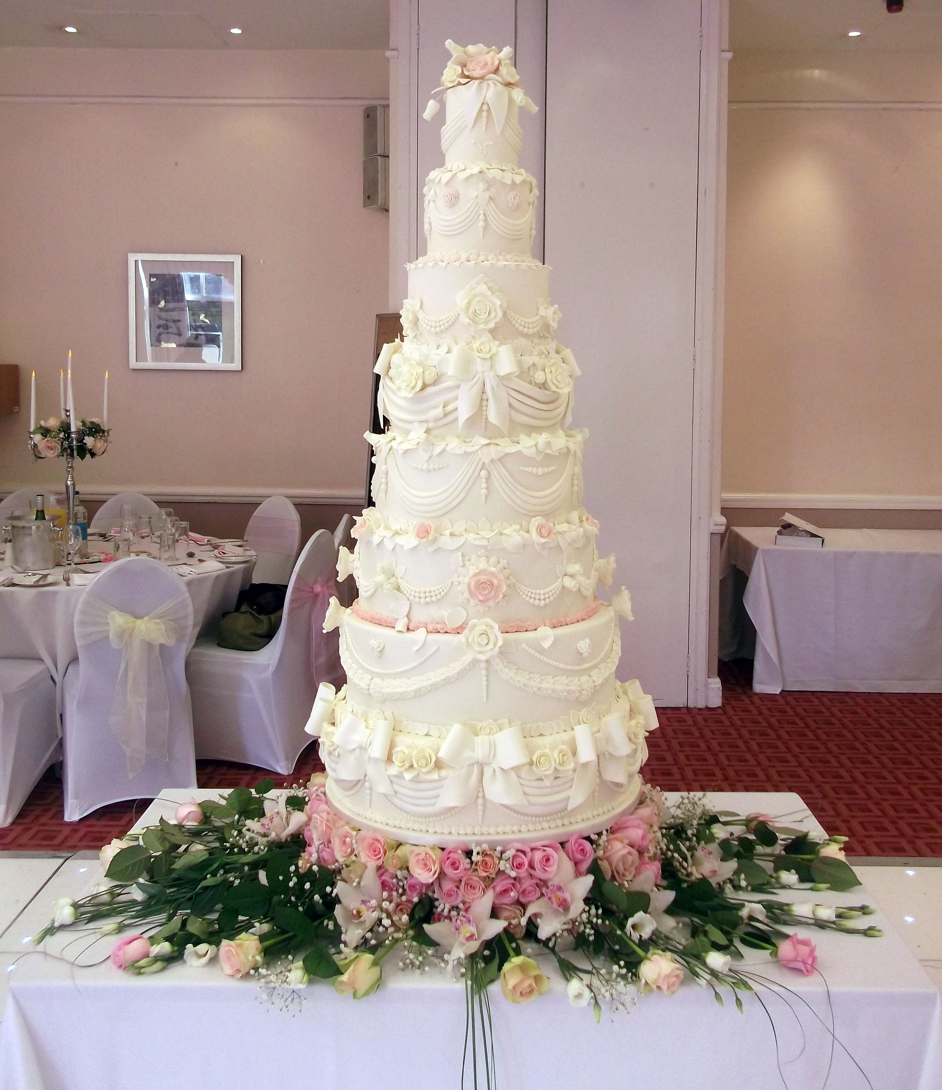 I loved making this 9 tier wedding cake, including a fresh floral ...