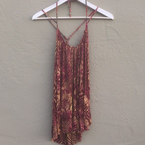 Free People Top Halter top with crossed straps in the back. Longer in the back. Free People Tops