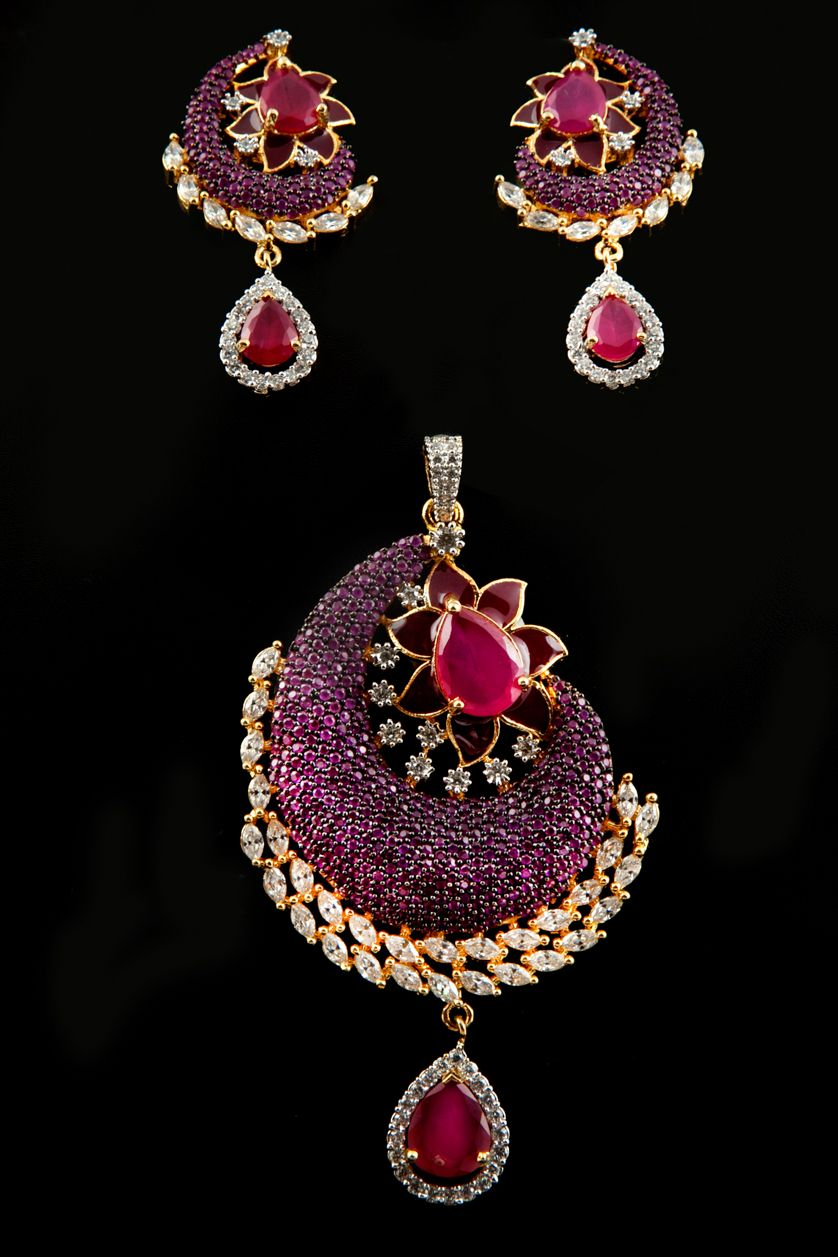 Colored american diamond pendant set in gold plating with ruby
