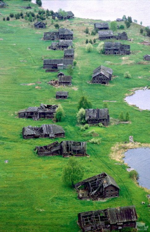An array of abandoned timber cabins - Karelia, Russia #abandoned #places #ruins #haunted #ghost #town #wrecked #deserted #worn #neglected