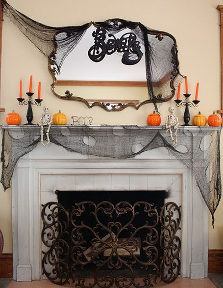 halloween mantle decor ideas use cheese cloth to create the draping and tattered effect - Halloween Clearance Decorations