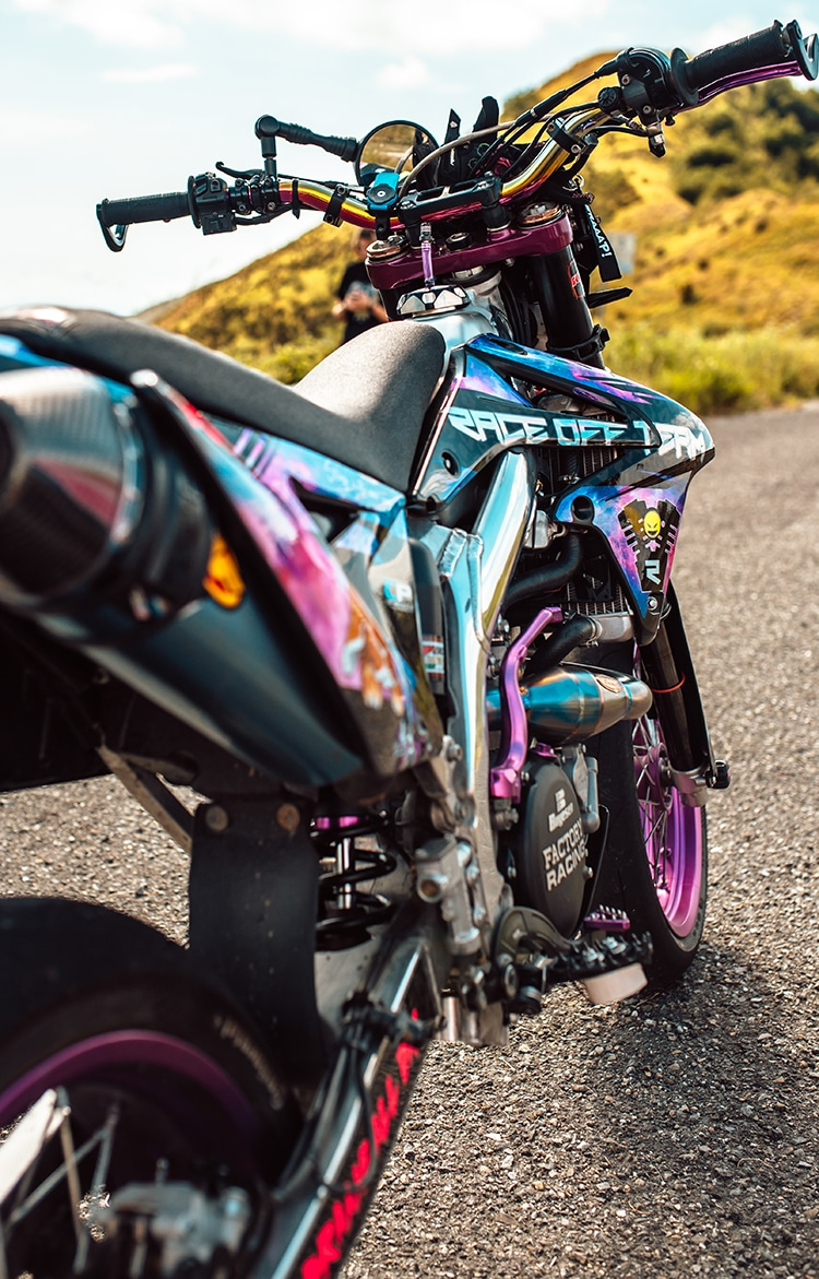 Biker Girl on a Rainbow Colored Custom Supermoto