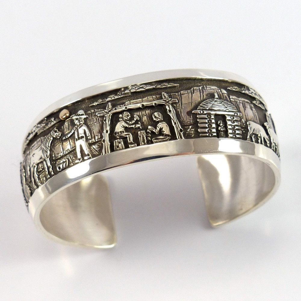 Sterling silver cuff bracelet featuring a beautiful overlaid navajo