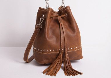 Learn More About The Roots Handbag