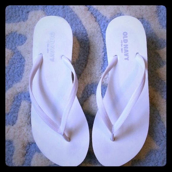 """Wh ite Wedge Sandals NWOT White sandals with approx 2.5 inch heel. Never used. Lost tags but they were a 7. When I measured (refer to pic #4), shows about a 9"""" which is inaccurate for sizing purposes due to the top of sandal wiggle room. They fit like a 6.5 or 7. Old Navy Shoes Sandals"""