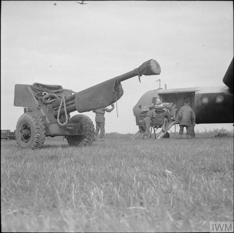 A jeep is unloaded from a Horsa glider during a large-scale airborne forces exercise, 22 April 1944. In the foreground a 6-pdr anti-tank gun has just been offloaded.