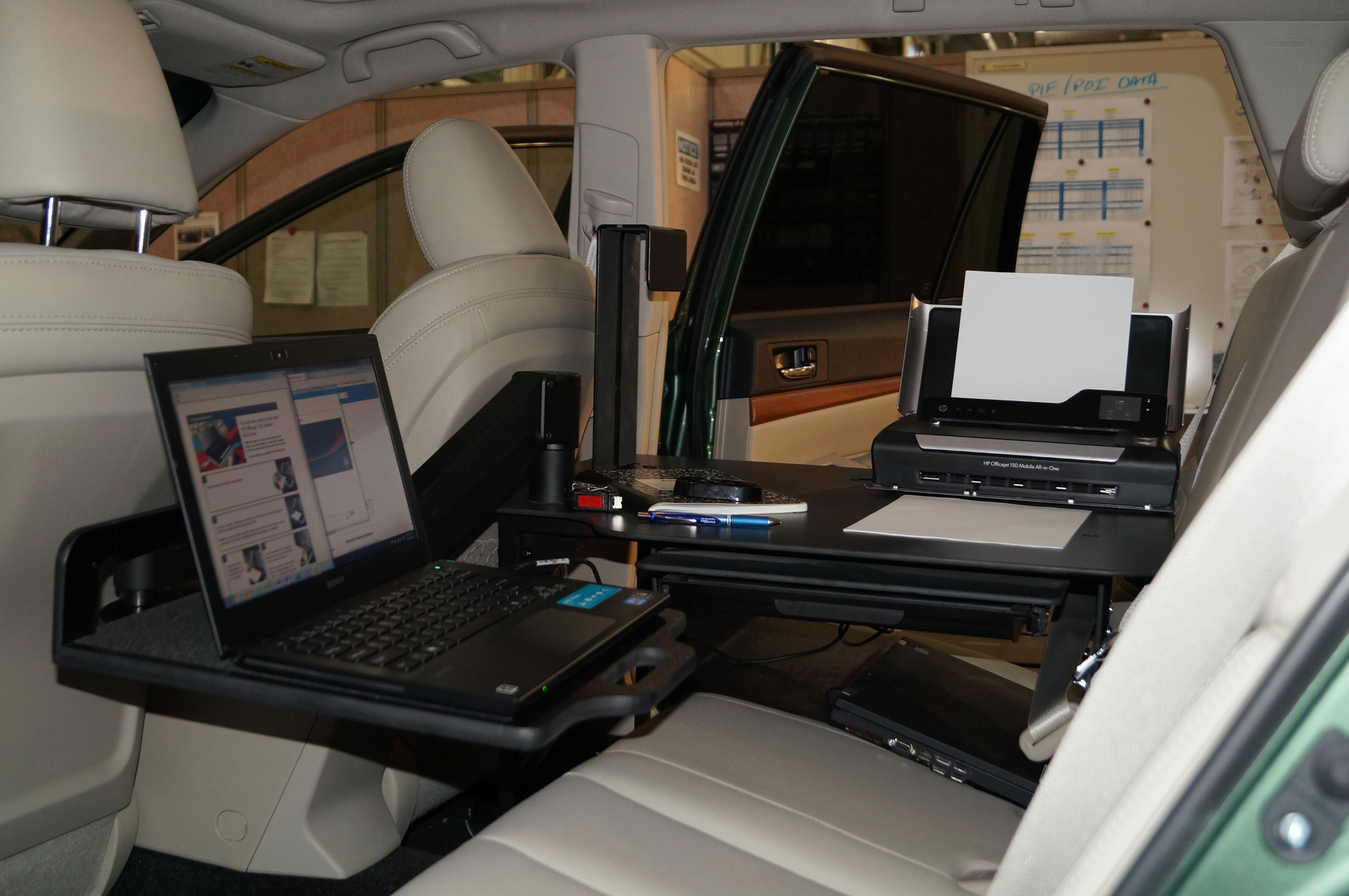 universal car desk equipped with a laptop and printer to create a