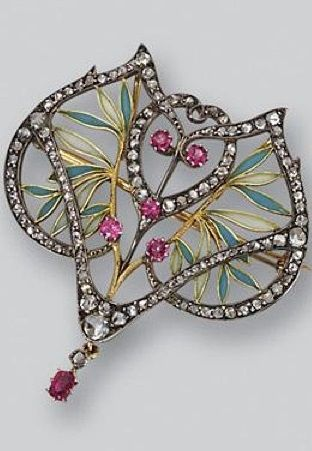 An Art Nouveau gold, plique-à-jour enamel, ruby and diamond pendant-brooch, Masriera, circa 1900. The openwork plaque decorated with green and blue plique-à-jour enamel leaves and studded with 5 round ruby berries, further decorated with rose-cut diamonds, anchored by an oval ruby and rose-cut diamond pendant, signed Masriera H.