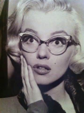 """Miss Monroe with cats close-up in """"How to Marry a Millionaire."""""""