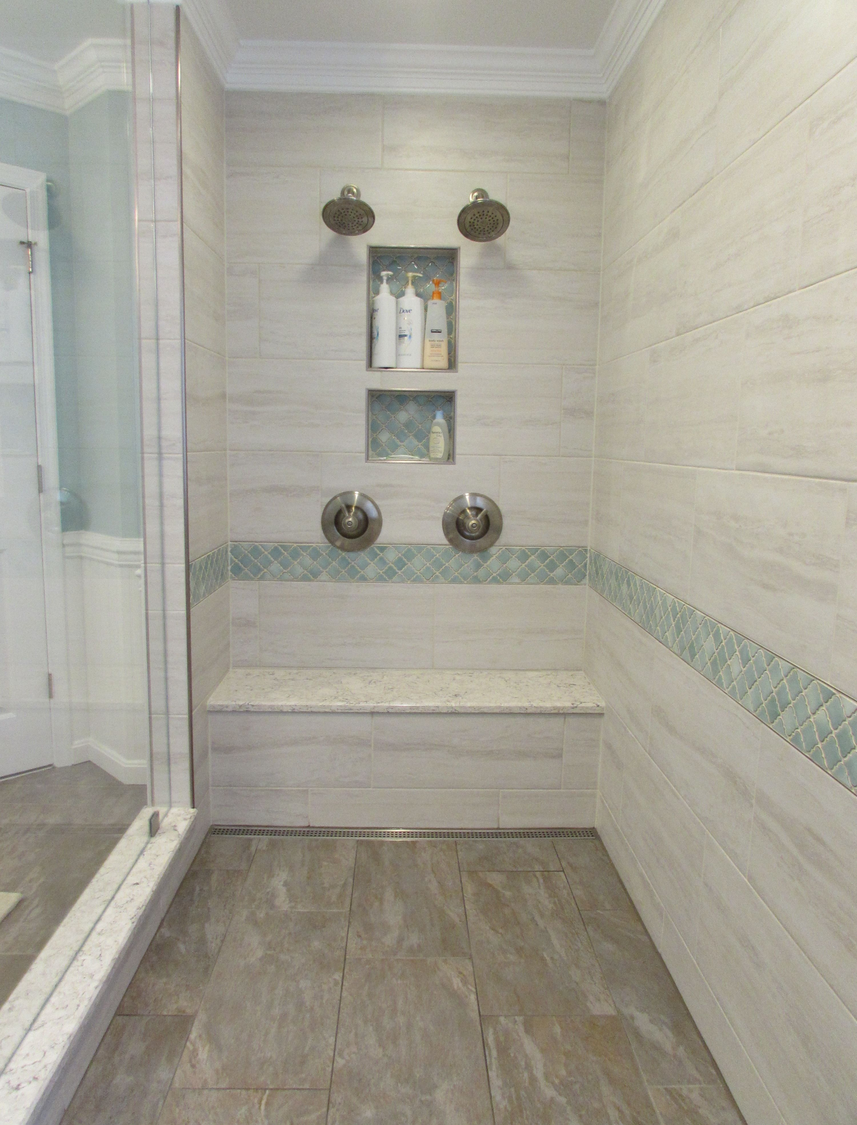 Custom Walk In Shower With Ceramic Tile Niches And Bench In A
