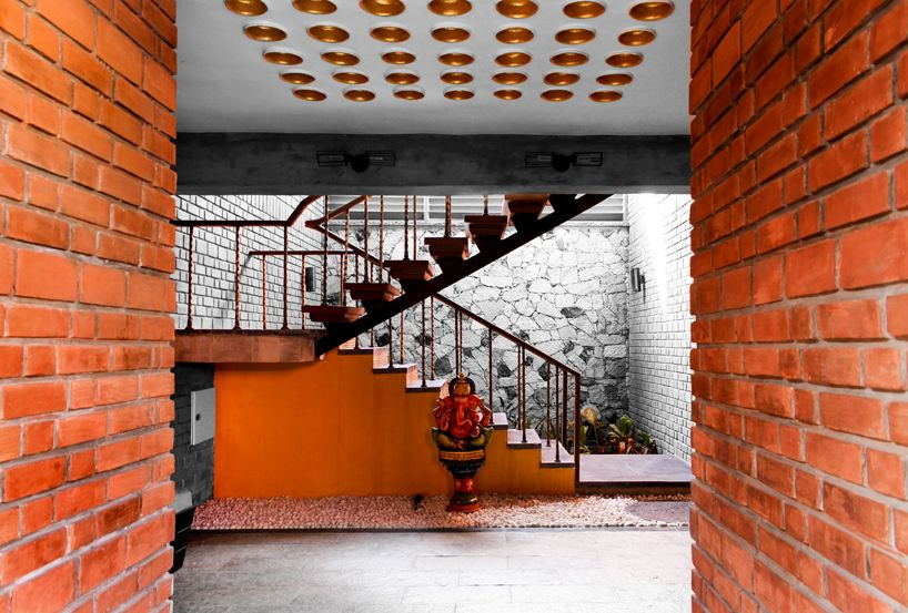 twisted columns sustain this red brick home by d6thD design | Home