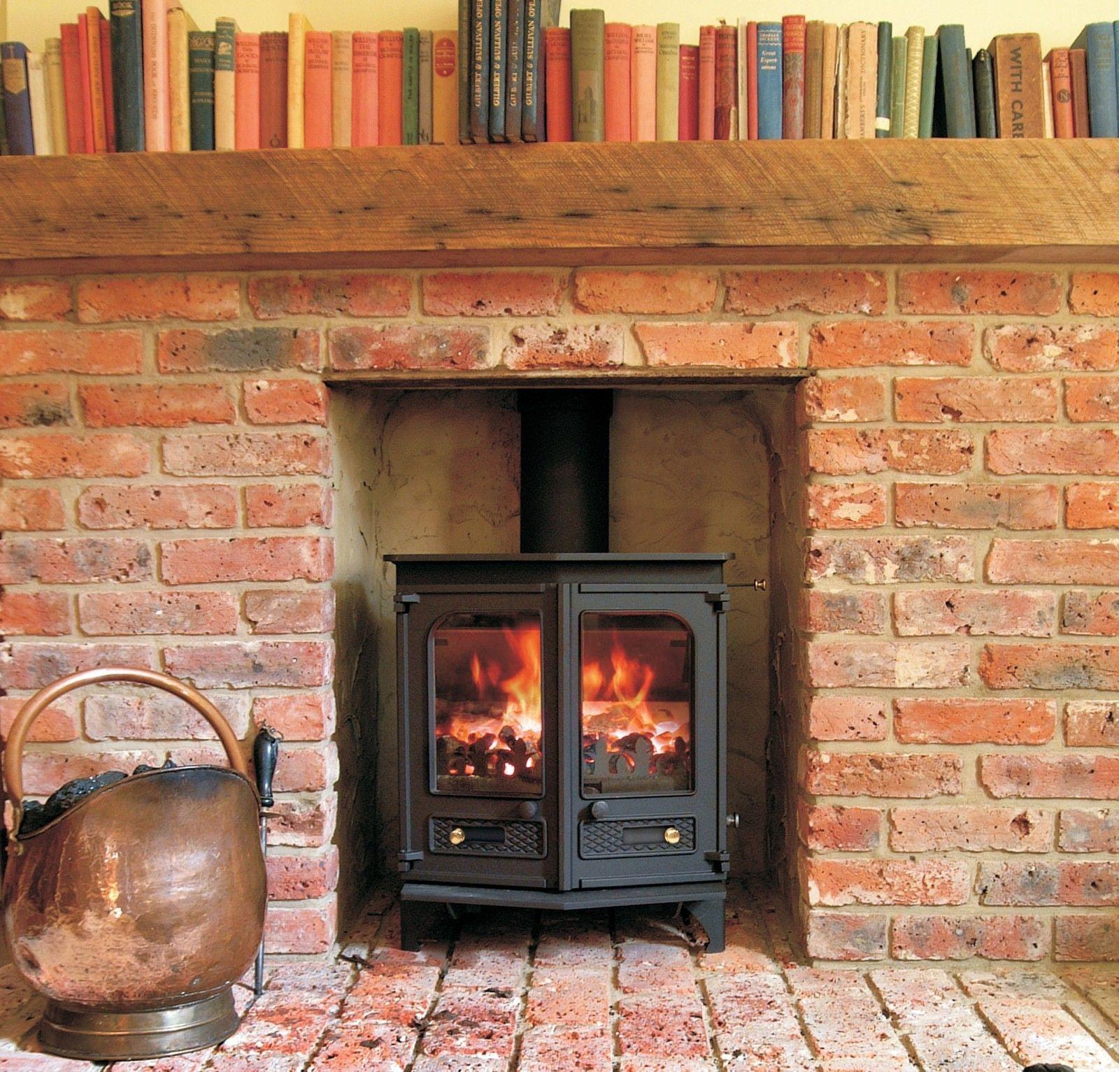 Brick fireplace with log burner rustico pinterest for Hogares a lena rusticos