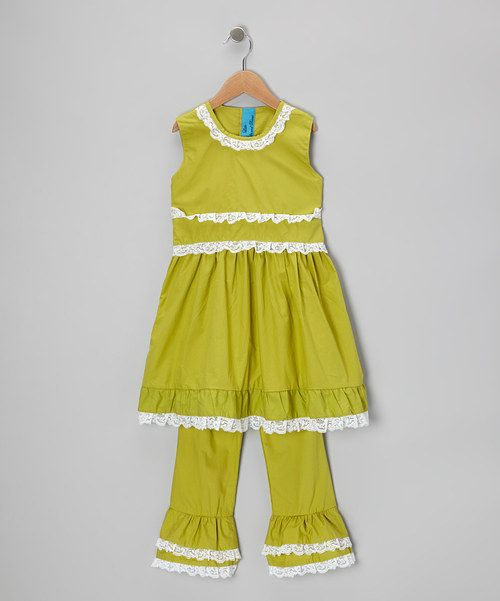 This stellar cotton set is sweet as candy and pretty as a picture. The tunic is adorned with delicate lace trim and a sweet silhouette that ties in back, while the matching pants sport eye-catching ruffle trim and a comfy elastic waistband.Includes tunic and pants