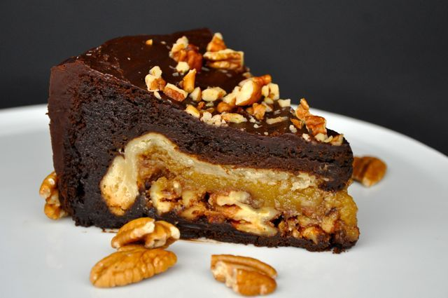 """Chocolate Pecan Pie-Cake - a pecan pie baked inside a chocolate cake, then frosted with Chocolate Ganache Frosting and decorated with Toasted Pecans!!! A decadent dessert from this blog, """"Making Life Delicious""""."""