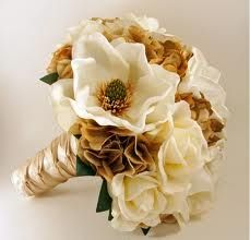 Looks VERY similar to my magnolia gold bouquet I made!    magnolia bouquet. Gold/brown flowers