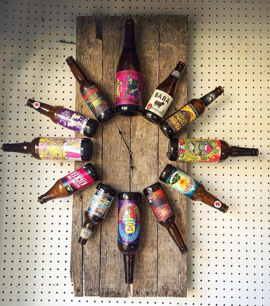 Beer o 39 clock repurposed beer bottles on reclaimed wood for Large bottle caps for crafts