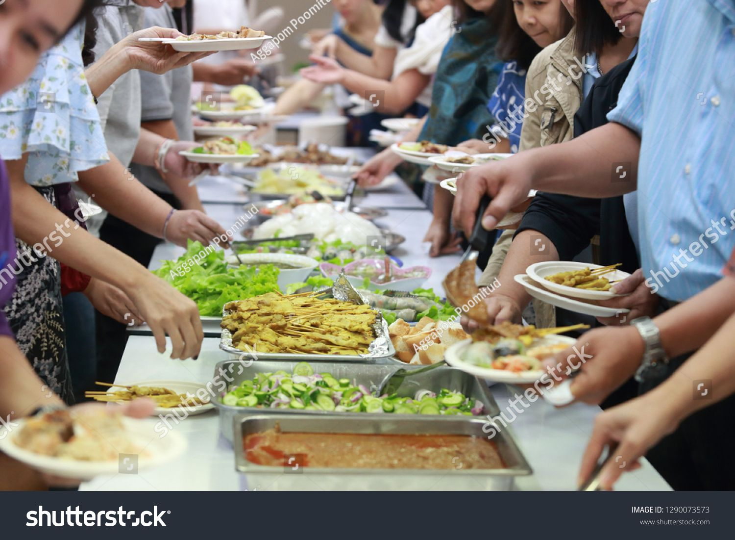 The People Are Enjoy The Buffet Food With The Asian Food With