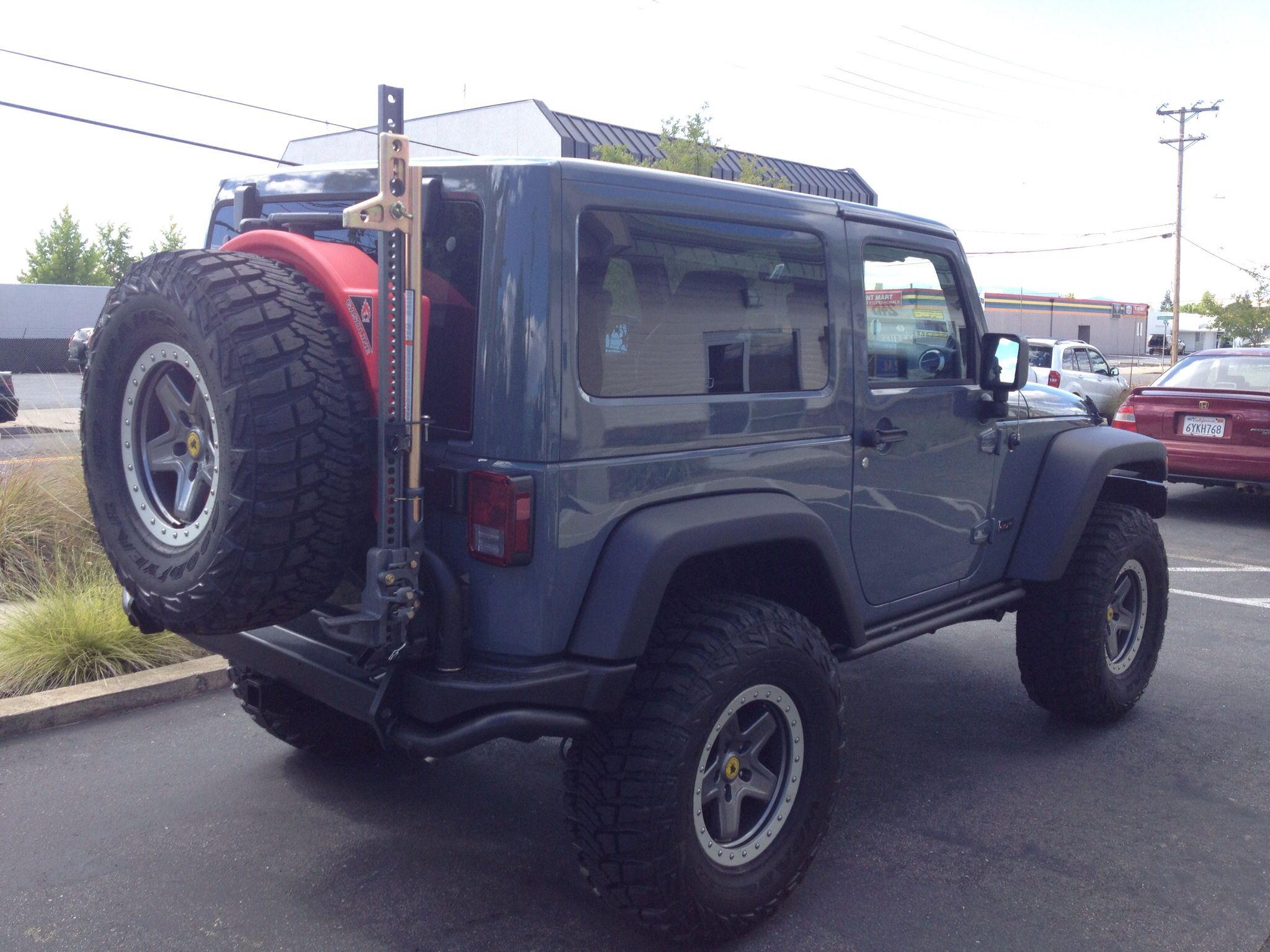 Aev tire carrier w highlift jack pull pal 10 gallon gas tank