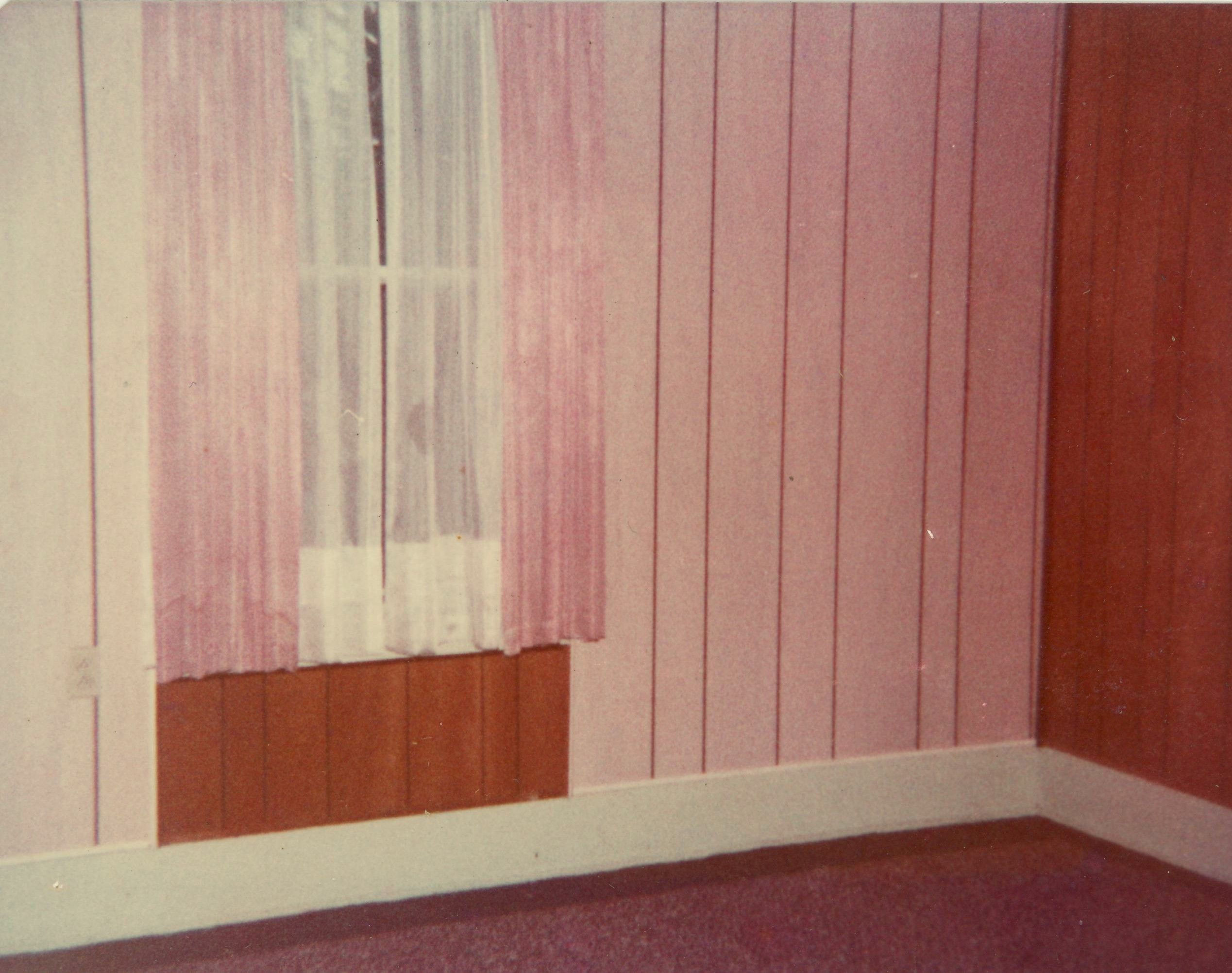 One of our children, Donna, picked this room. It had stripes of brown and grey panelling around the room. She redecorated it with paint and wallpaper and later, after she was an adult, came and took the walls down to the studs so we could turn it into a guest room for our granddaughters.
