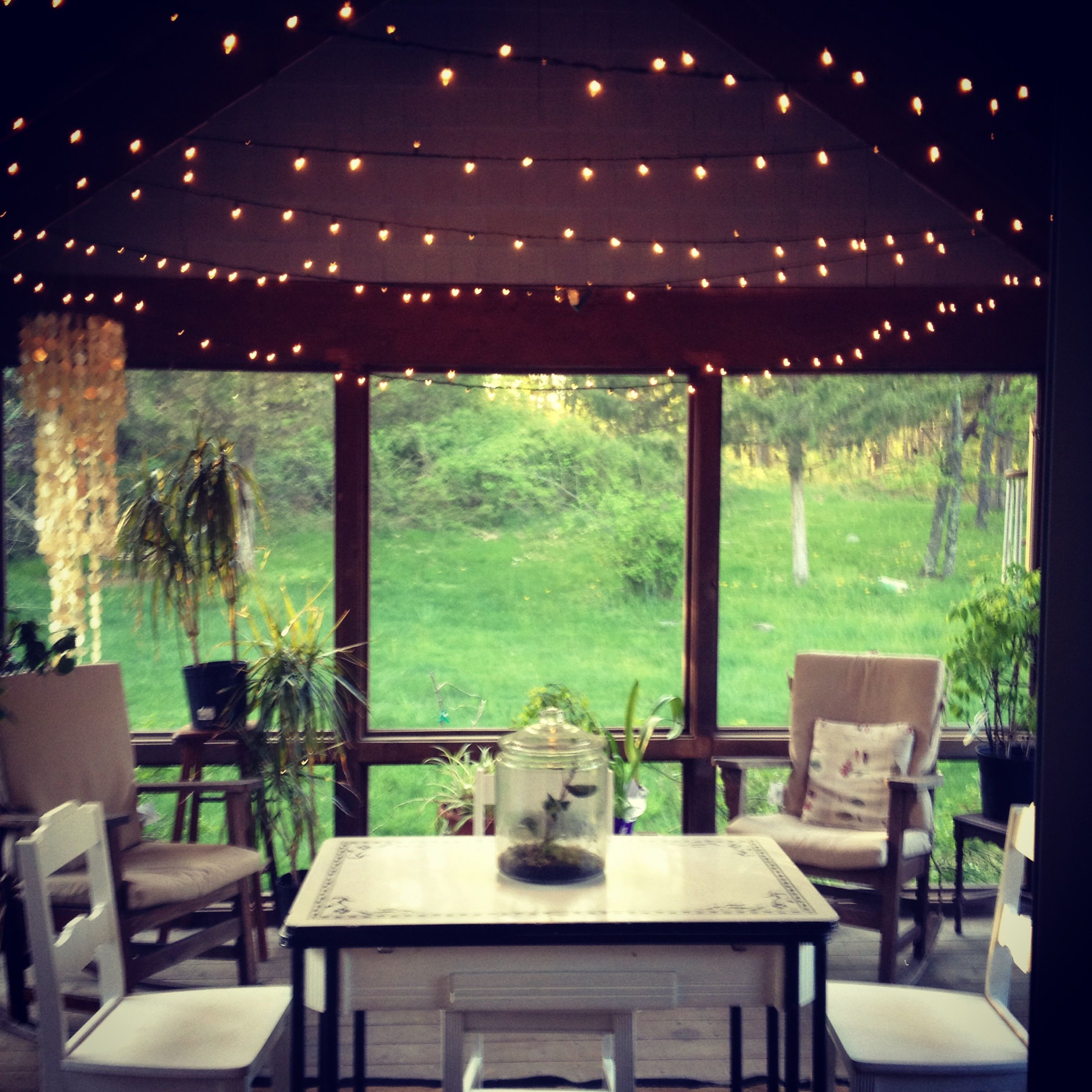 Art Deco Porch: Small Screened Porch With Lights And Enamel Table, White