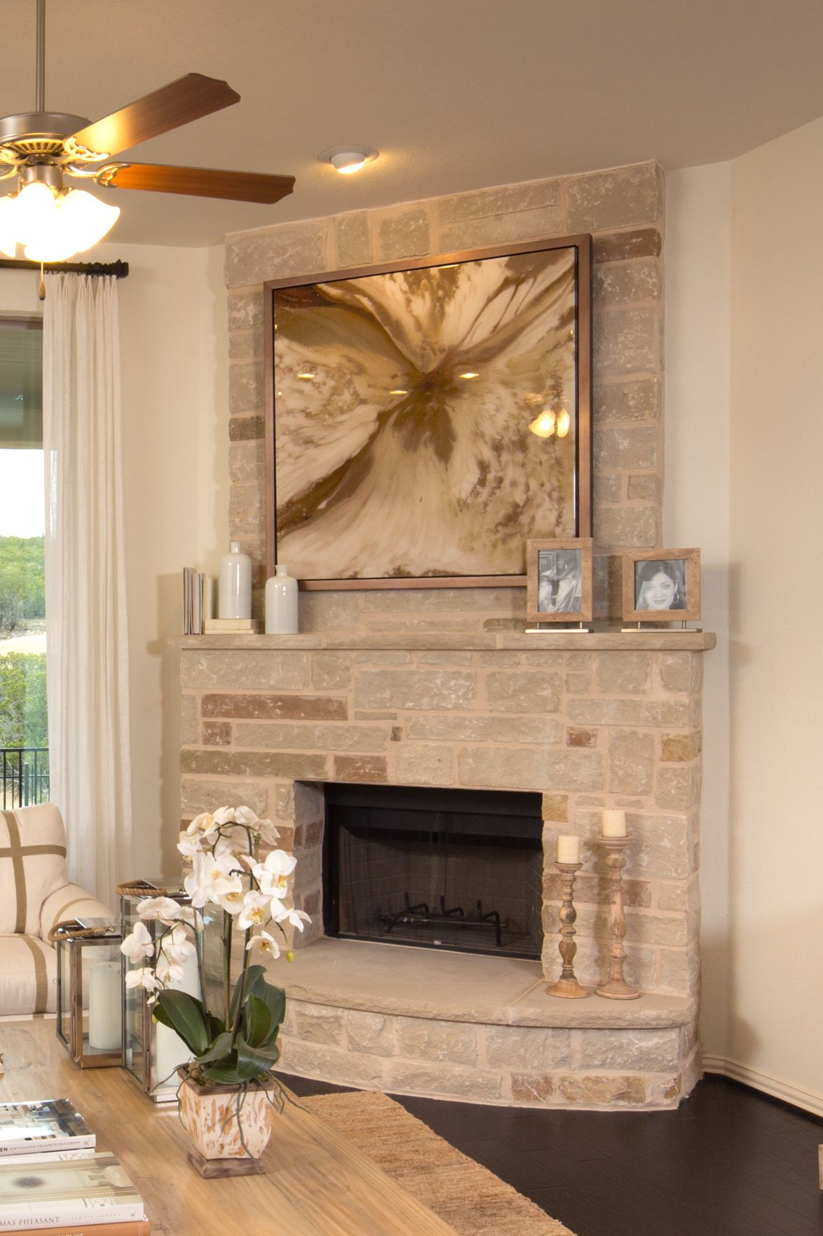 weathered stone creates a fireplace with a feeling of history