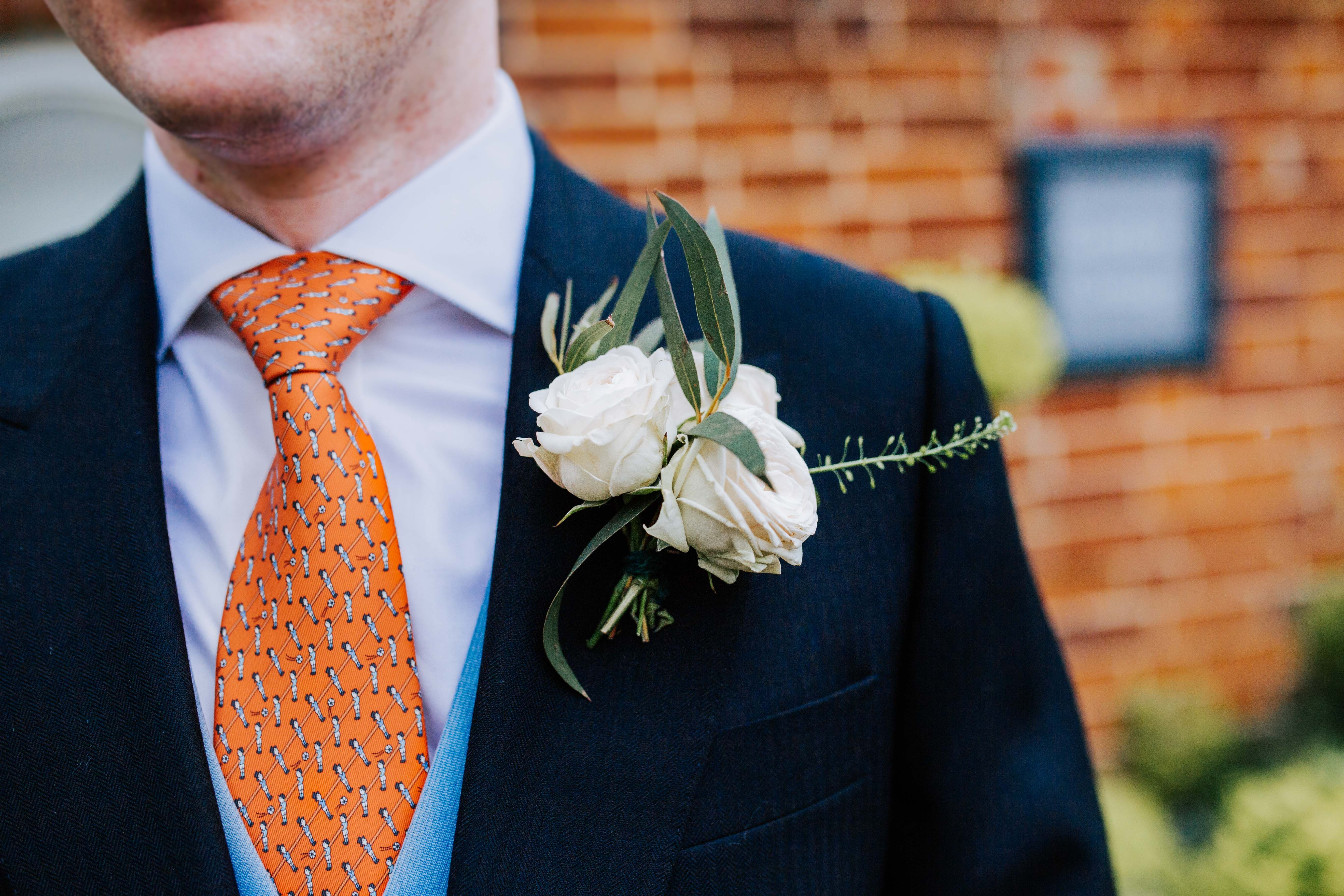 35d0cc76524e Groom wedding style // Hermes orange tie and beautiful double flower  buttonhole / boutonniere.