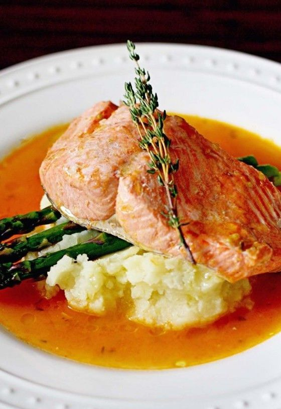 Poached Salmon in Tomato Broth. Healthy eating.