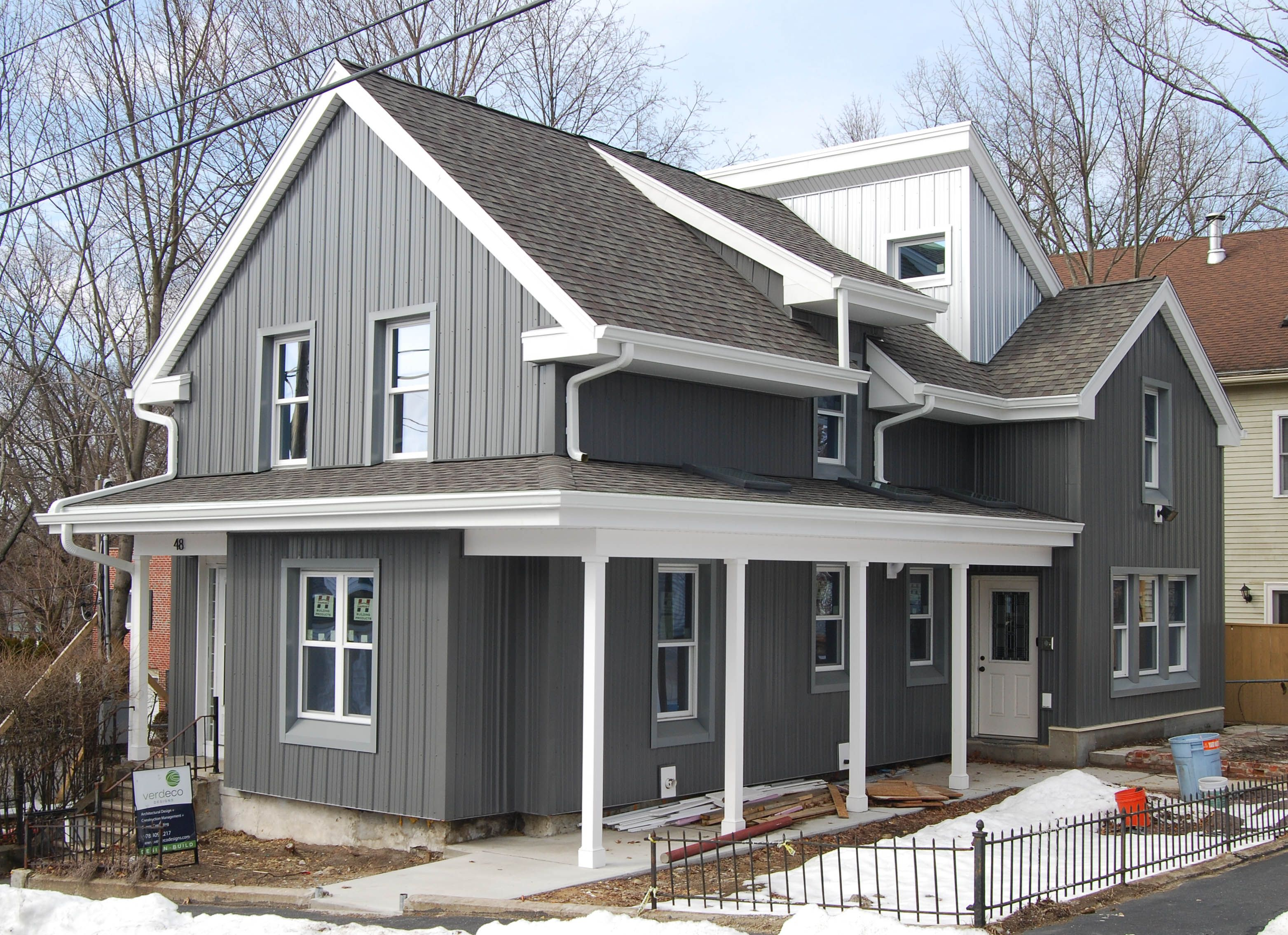 The boldness of the metal siding is softened by the muted for Siding choices