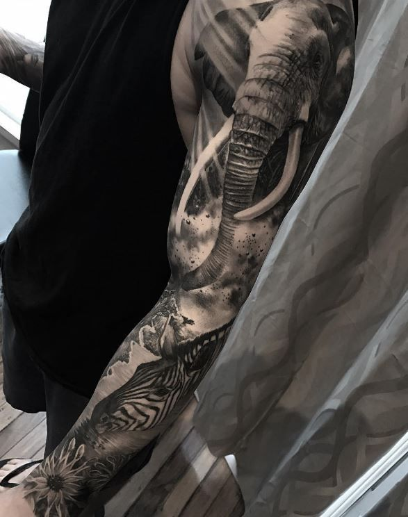 African Nature Sleeve Tattoo Inkstylemag Nature Tattoo Sleeve Animal Sleeve Tattoo Animal Tattoos