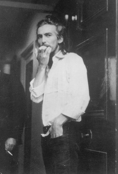 George Harrison..My favorite picture of him because it looks like he just answered the front door at his home.