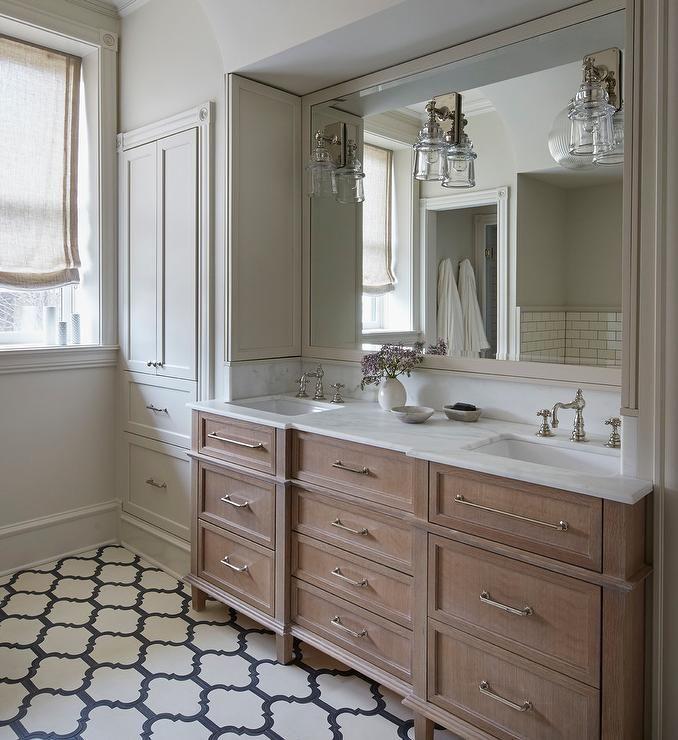 Charming Bathroom Boasts A Brushed Oak Dual Vanity Adorning
