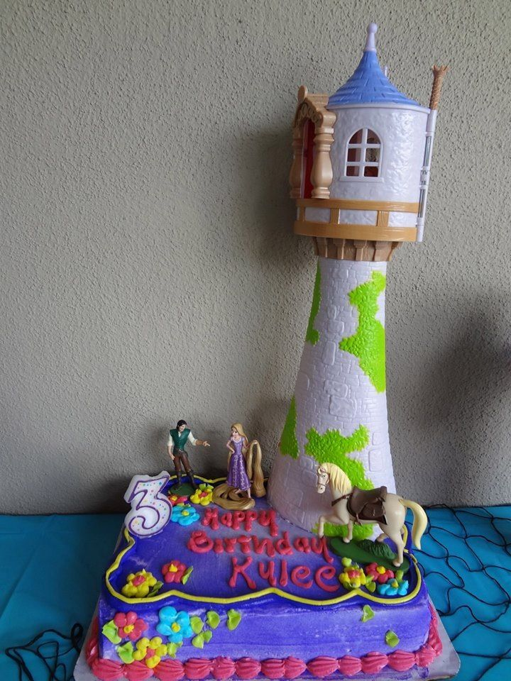 Kylees rapunzel cake i bought the tower castle at toys