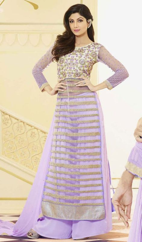 Let your adorable looks create a stunning impact like Shilpa Shetty as you walk out in this lavender embroidered net palazzo suit. Beautified with floral patch, lace, resham, sequins and stones work. #AdornLavenderTransparentNetPalazzoSuit