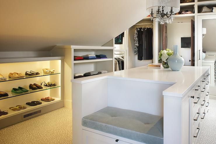 Large Walk In Attic Closet Features A White Center Island Fitted With Drawers Donning Bronze Hardware