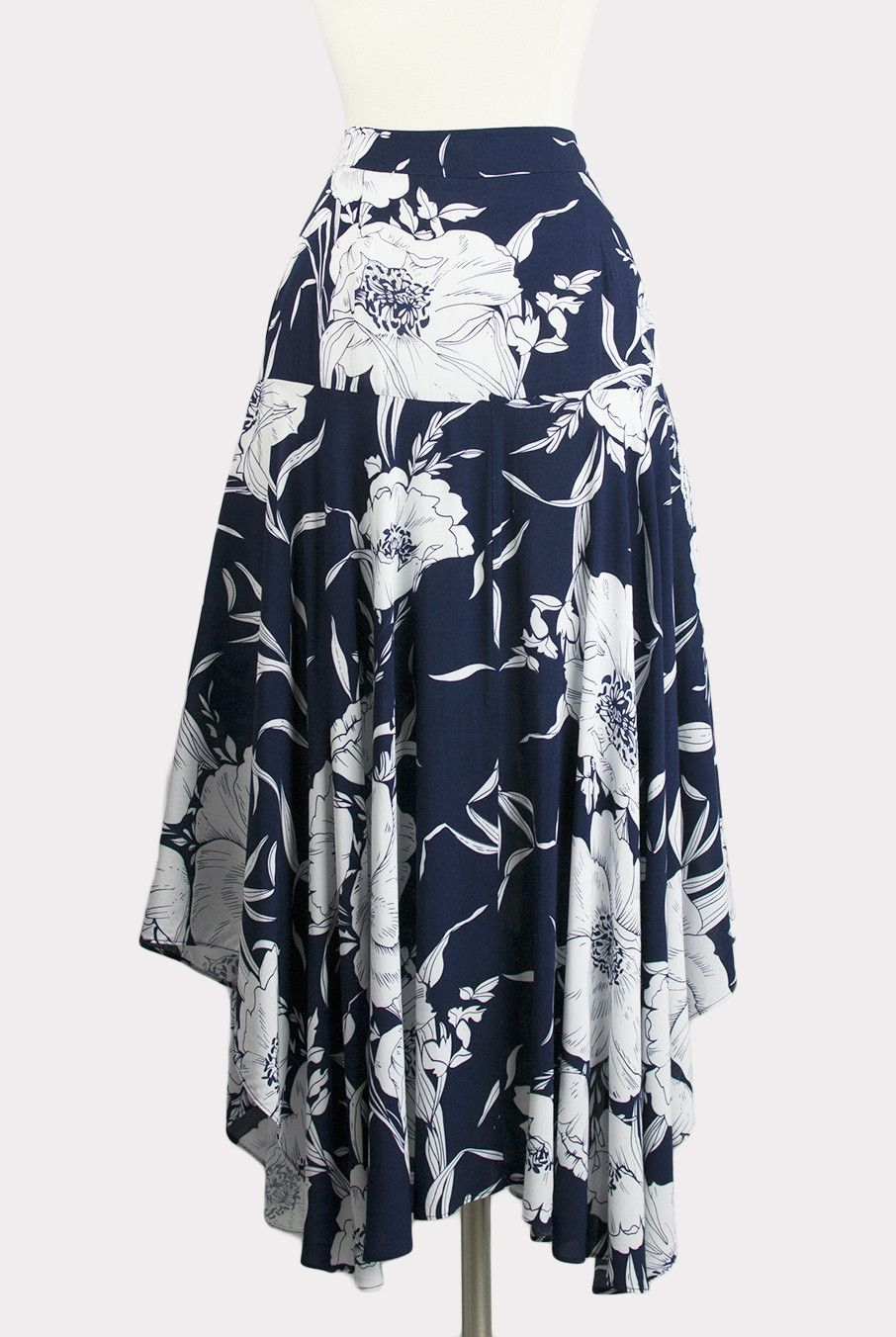 f5492352c This item is Final Sale. Navy blue skirt with white over-size floral print,  asymmetric hemline and hidden side zip closure. Partially lined.