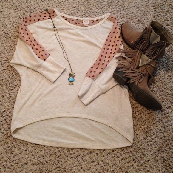 Cream cotton top with sheer back and sleeve Mossimo cream color top with burgundy sheer heart material down the top part of the sleeves and at top of the back. Very cute shirt. Hi-Lo type of shirt. Very soft and size M. EUC and smoke free home. Mossimo Supply Co Tops Tees - Long Sleeve