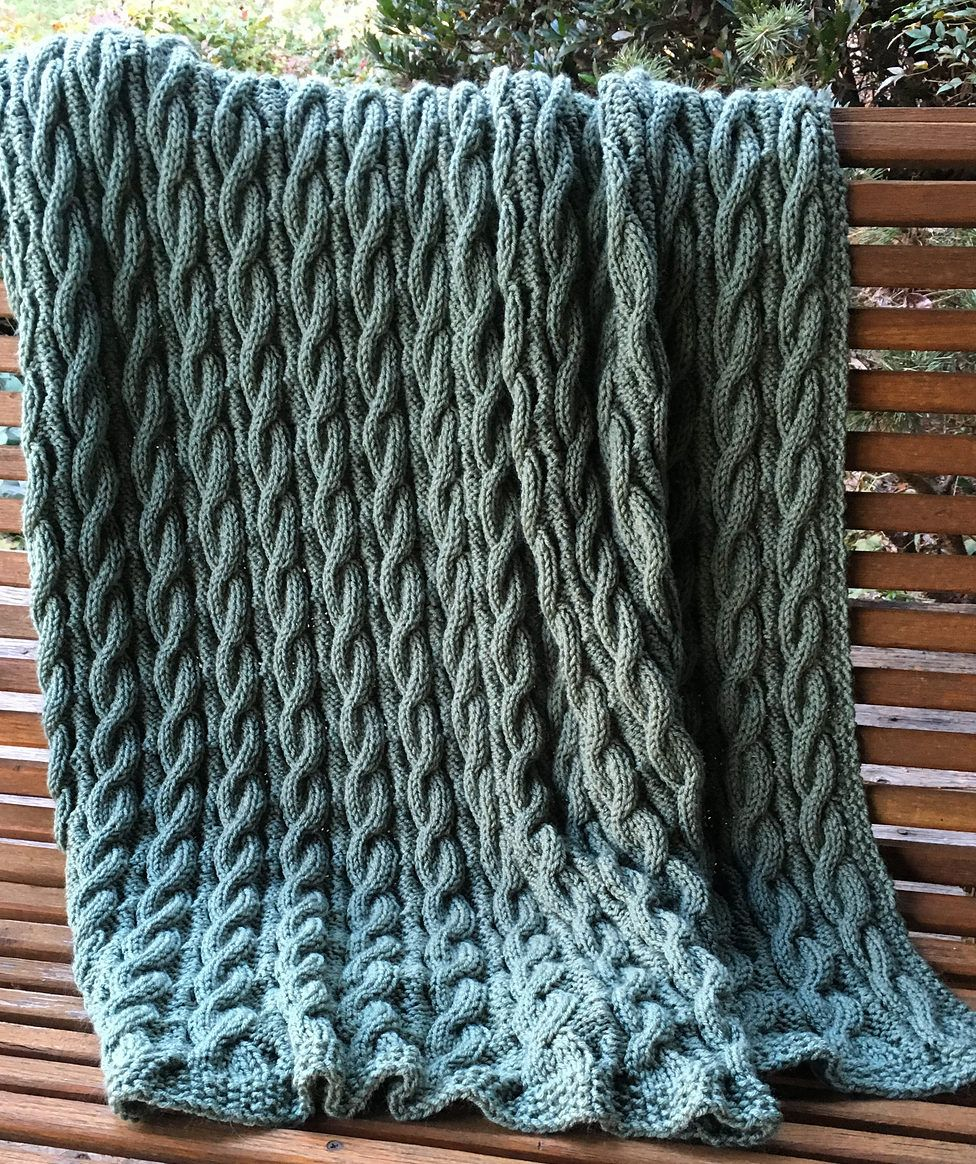 "Free Knitting Pattern for Reversible Cabled Classic Throw - A simple cable pattern reveals cables on both sides of the blanket. Designed by Red Heart. 46½"" X 60"". Most Ravelrers rate this as easy. Pictured project by lnewnam"