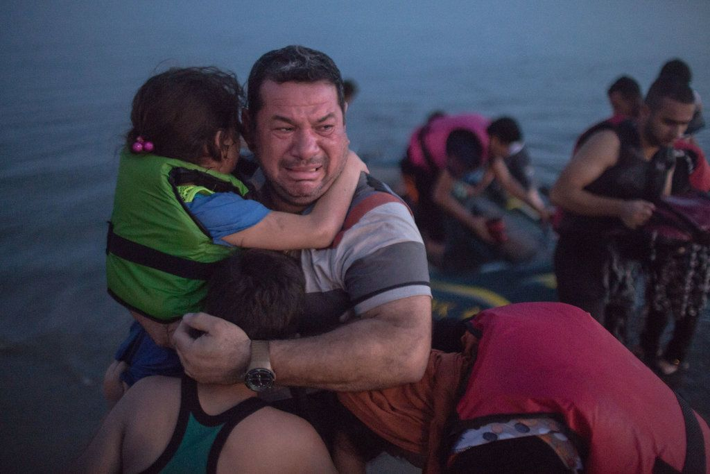 KOS, GREECE 8/15/2015 Laith Majid, an Iraqi, broke out in tears of joy, holding his son and daughter, after they arrived safely in Kos on a flimsy rubber boat. Daniel Etter for The New York Times