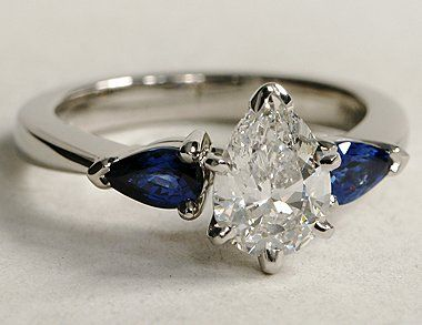 My Dream Ring 2 5 Ct Pear Diamond Centerstone With 1 1 2 Carat Each Blue Sapphire Pe Engagement Rings Sapphire Pear Shaped Engagement Rings Blue Sapphire Pear