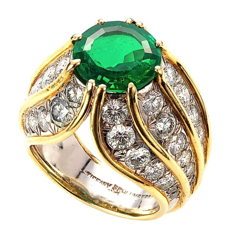 3256303b0 A very fine Colombian octagonal natural emerald, mounted with diamond in a  gold and platinum