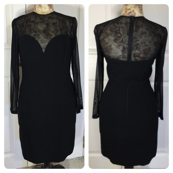 Escada Couture black dress Stunning black wool dress with sheer top and long sleeves. Figure flattering and comfortable. Beautifully constructed. Back zipper. Escada size 36. Great shape. Escada Dresses