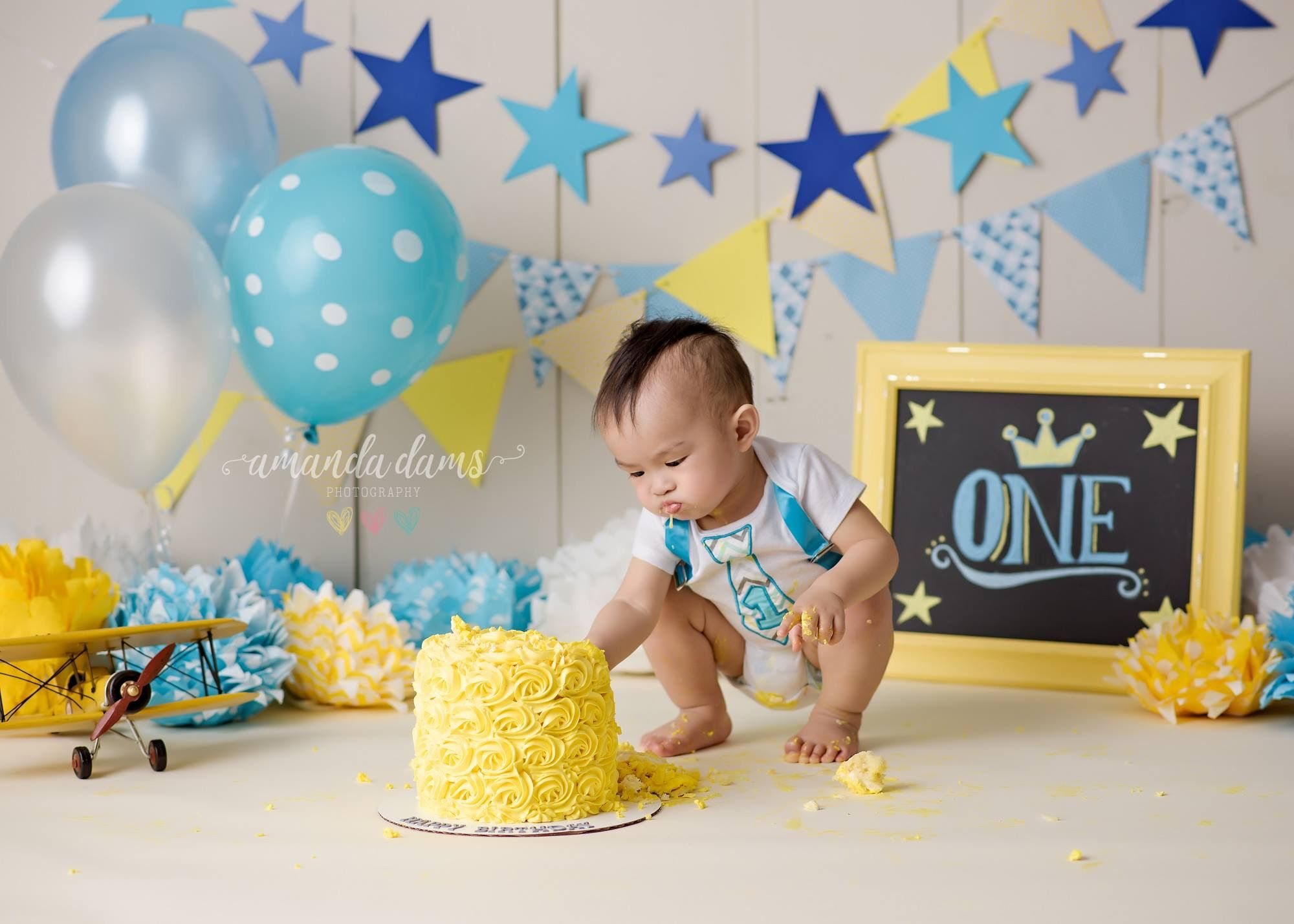 Cake smash first birthday baby boy blue yellow stars