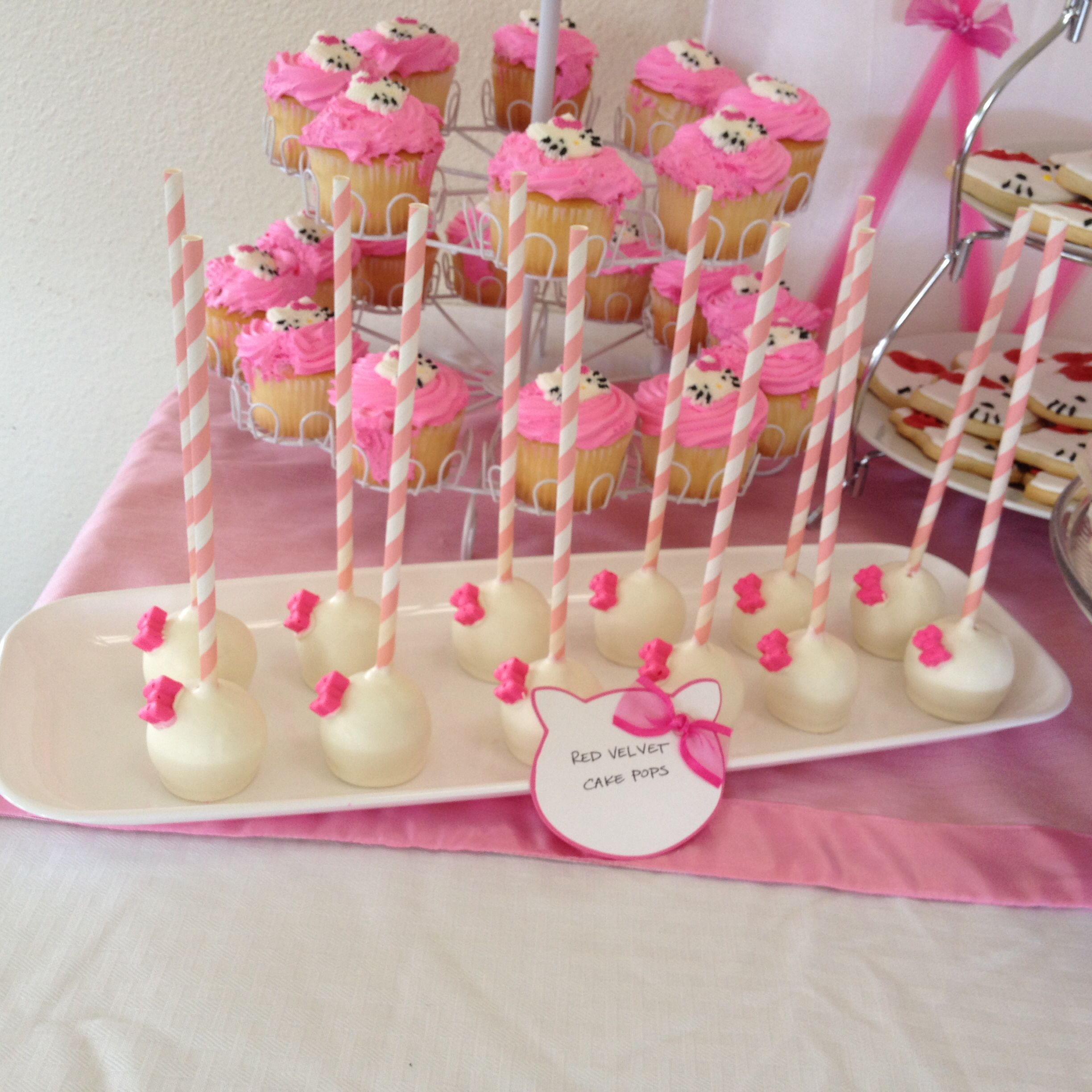 Cake pops for hello kitty baby shower dessert table