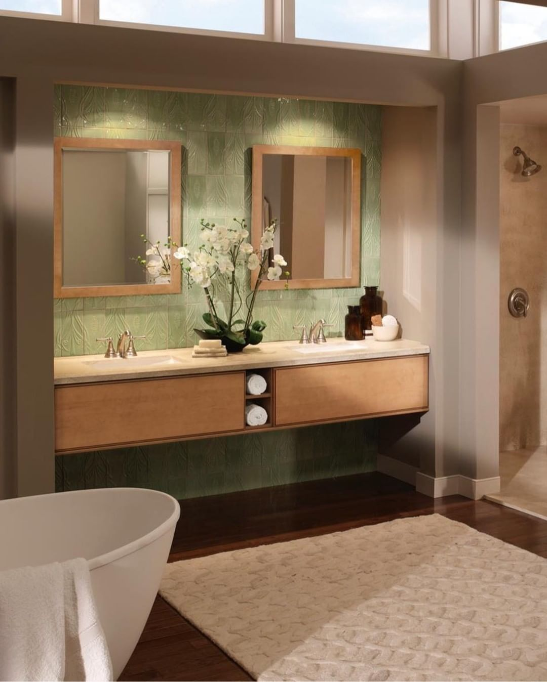 A modern bathroom design with a subtle pop of color to ...