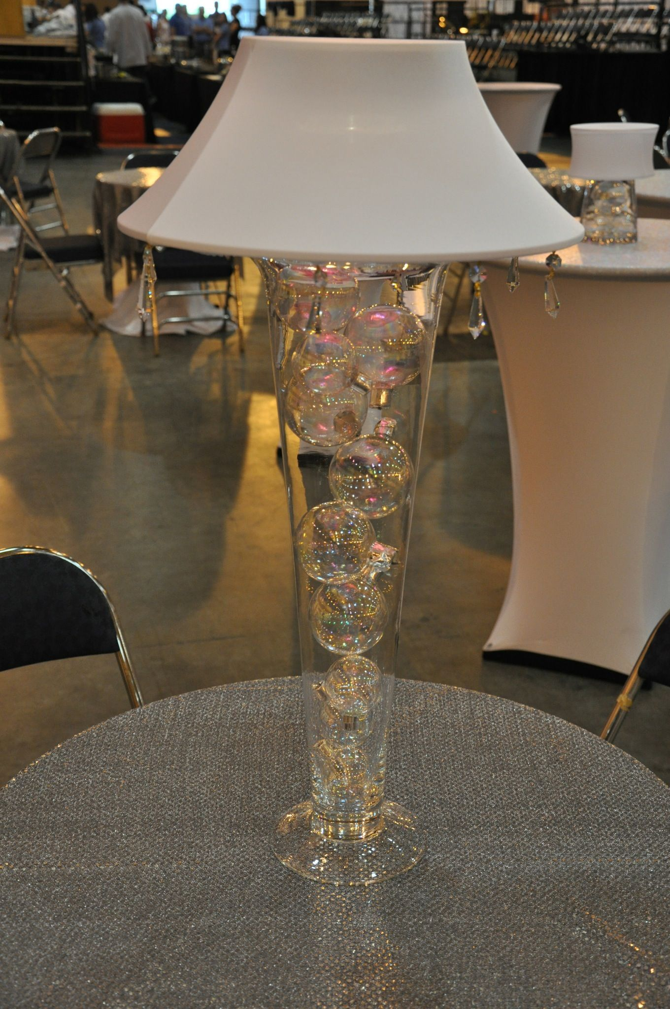 Great for a New Year's Eve or Christmas Party...Glass filled with ornaments and a lighted lampshade. To get this look, please visit www.fancyfaces.com