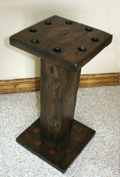 A rustic cue stand that holds 8 cues - the perfect complement to your billiard table.
