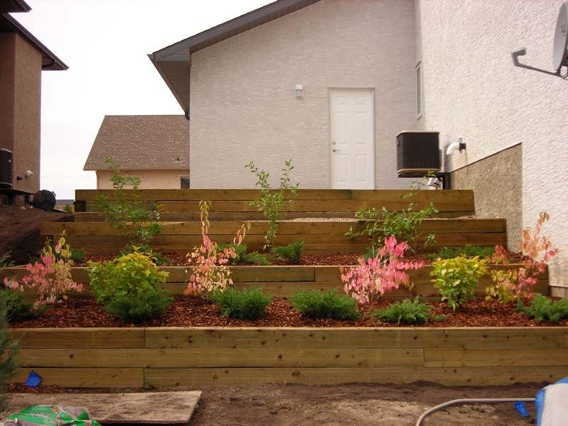 wooden retaining wall steps gentle earth design studio portfoliolandscaping saskatoon gentle - Timber Retaining Wall Design