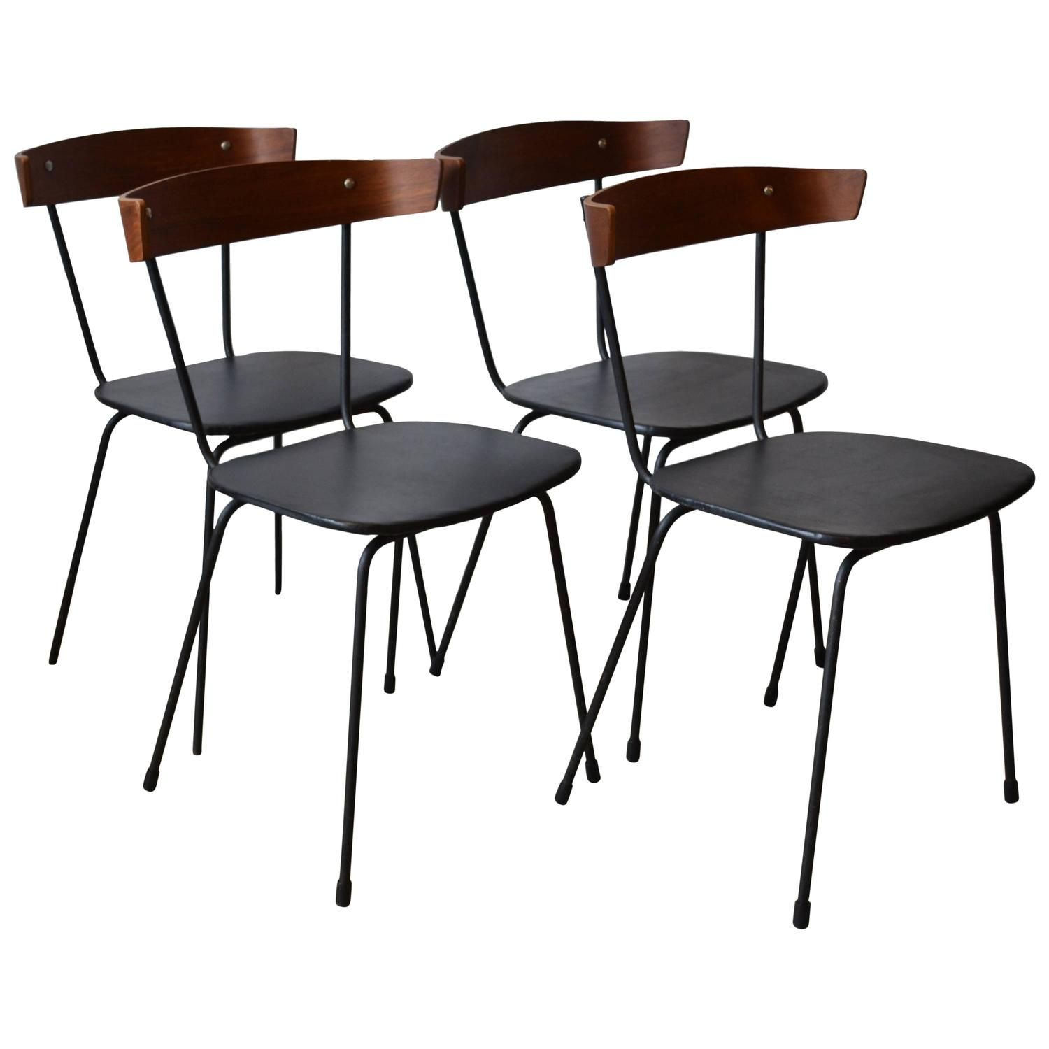 Set of four iron and bent wood back dining chairs style of paul